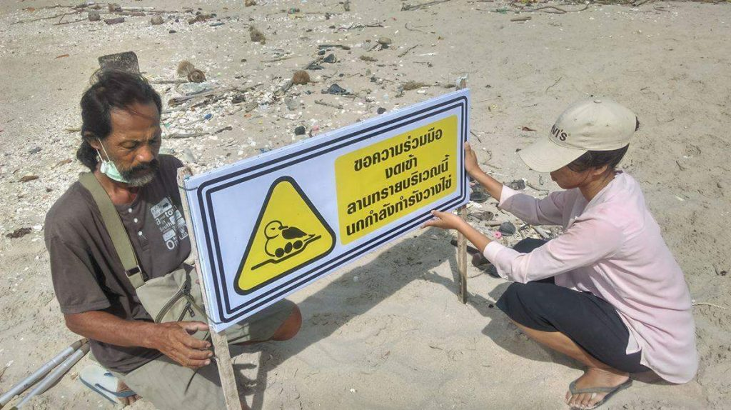 Mr. Daeng installing signs at Laem Phak Bia